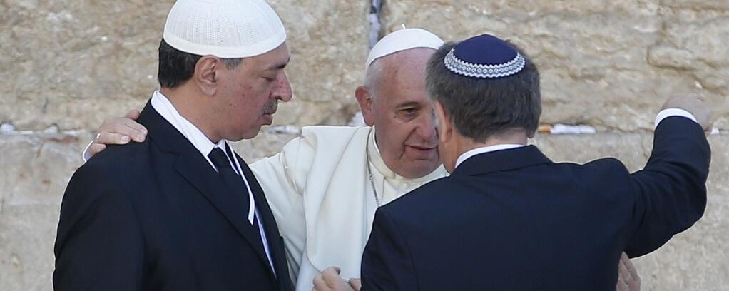Francis hugs Muslim and Jew