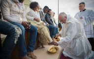 "In this handout picture released by the Vatican Press Office, Pope Francis performs the foot-washing ritual at the Castelnuovo di Porto refugees center near Rome on March 24, 2016. Pope Francis washed the feet of 11 young asylum seekers and a worker at their reception centre to highlight the need for the international community to provide shelter to refugees.    Several of the asylum seekers, one holding a baby in her arms, were reduced to tears as the 79-year-old pontiff kneeled before them, pouring water over their feet, drying them with a towel and bending to kiss them. / AFP / STR / RESTRICTED TO EDITORIAL USE - MANDATORY CREDIT ""AFP PHOTO / OSSERVATORE ROMANO"" - NO MARKETING NO ADVERTISING CAMPAIGNS - DISTRIBUTED AS A SERVICE TO CLIENTS"