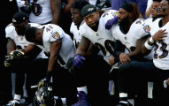 LONDON, ENGLAND - SEPTEMBER 24:  Baltimore Ravens players kneel for the American National anthem during the NFL International Series match between Baltimore Ravens and Jacksonville Jaguars at Wembley Stadium on September 24, 2017 in London, England.  (Photo by Alex Pantling/Getty Images)