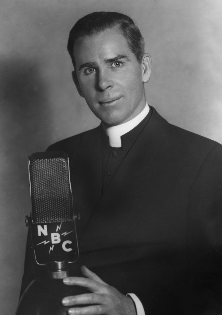 PORTRAIT OF FULTON J. SHEEN WITH RADIO MICROPHONE