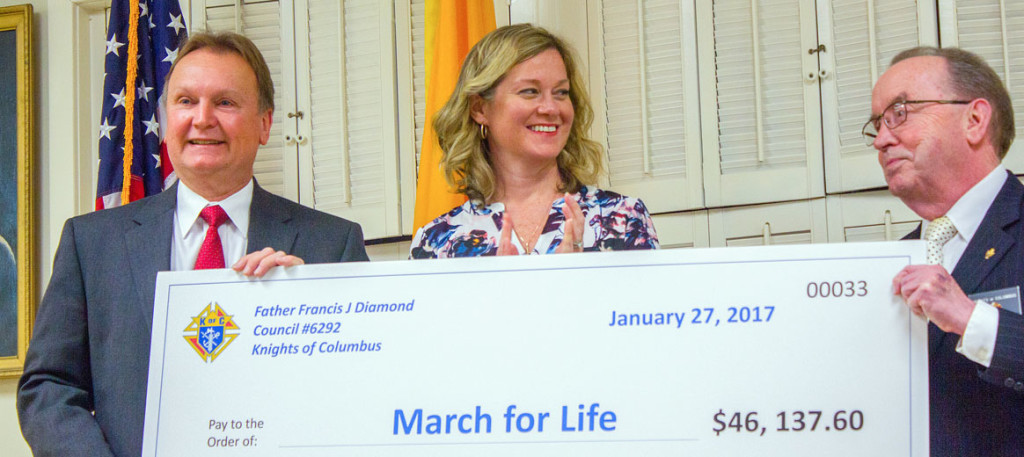 Jeanne Mancini (center) accepting a donation from a local Knights of Columbus Council, an amount that pales in comparison to the funds donated by Knights of Columbus Charities USA.